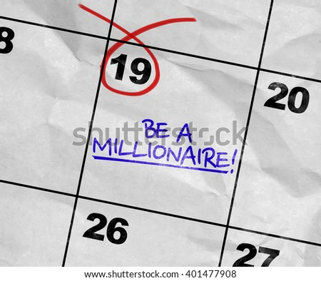 Concept image of a Calendar with the text: Be a millionaire! - stock photo