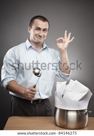 Concept image of a confident and successful businessman cooking contracts or paperwork - stock photo