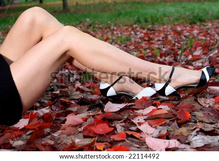 Concept image of a woman's attractive legs. Shallow depth of field focus point is at models  legs.