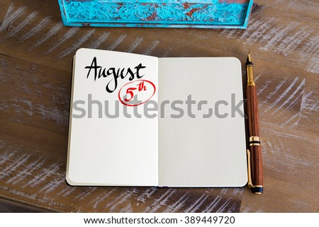 Concept image of August 5 Calendar Day with empty space for text as handwritten note with fountain pen on a notebook - stock photo