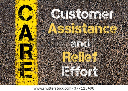 Concept image of Business Acronym CARE Customer Assistance and Relief Effort written over road marking yellow paint line - stock photo