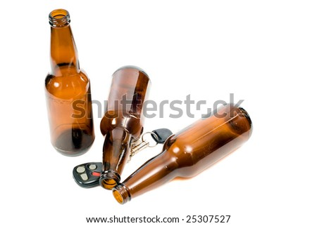 Concept image of drunk driving, with keys and empty beer bottles and the props - stock photo