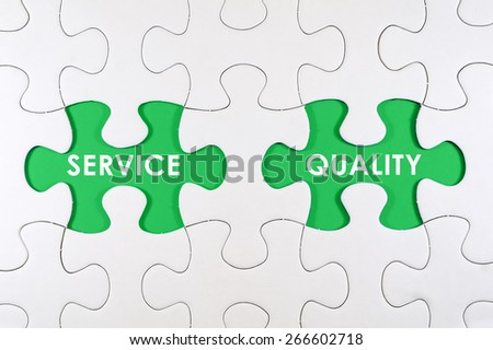 Concept image of missing puzzle pieces with SERVICE QUALITY words on green - stock photo
