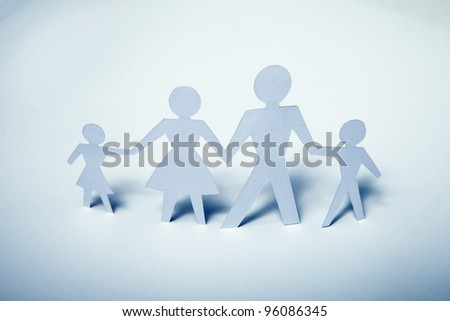 Concept image of paper cutout family