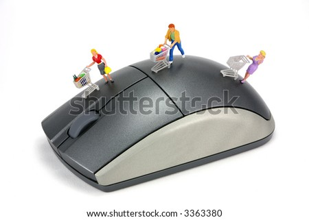 Concept image of shoppers on a computer mouse to represent online internet shopping. The shoppers have shopping carts. White background. - stock photo