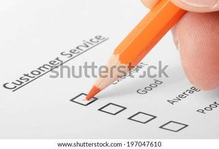 Concept image of someone completing a form showing the concept of participation or points of view.  - stock photo