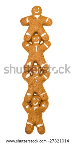 Concept image of teamwork by making gingerbread men supporting the one above him, isolated against a white background - stock photo