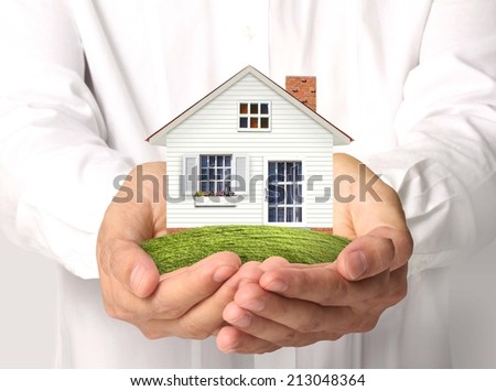 concept image, the house in human hands - stock photo