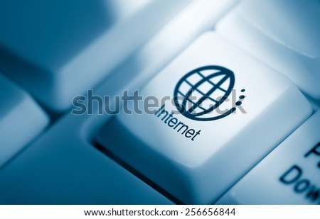 Concept image with internet and globe icon on computer keyboard - stock photo