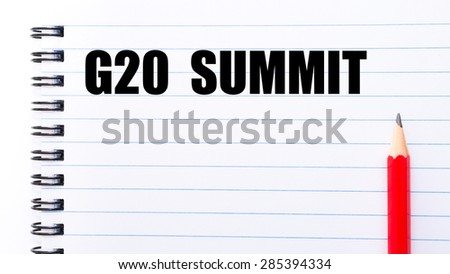 Concept image with words G20 SUMMIT written on notebook page and red pencil on the right
