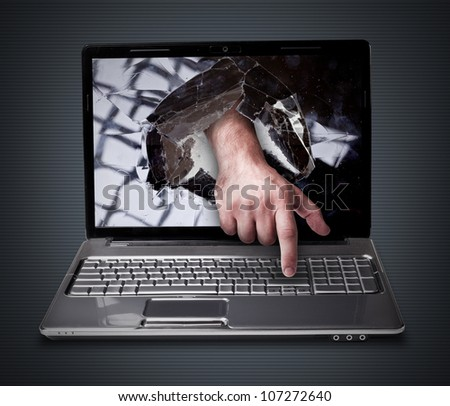 CONCEPT laptop with with broken screen the hand presses the button