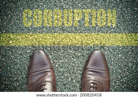concept message in the road with feet - corruption - stock photo