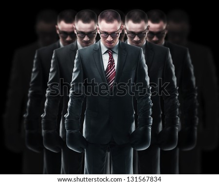 Concept (metaphor many people). Businessman with boxing gloves - stock photo