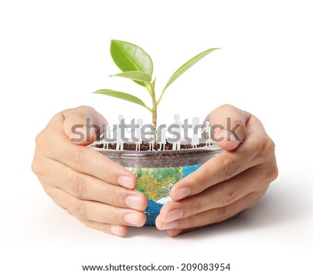 concept miniature globe showing, holding glowing earth globe in his hands - stock photo