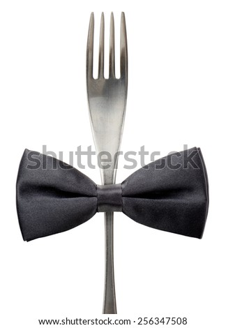 Concept of a black tie event, black bow tie on a fork - stock photo