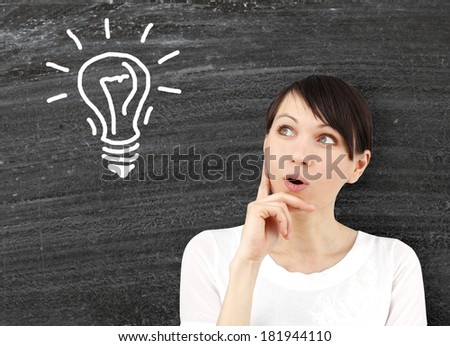 Concept of a young woman with ideas as symbol of creativity