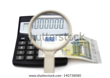 concept of accounting fraud with money,calculator,magnifier - stock photo