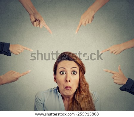 Concept of accusation of guilty businesswoman. Portrait confused upset woman many fingers pointing at her isolated on grey office background. Human face expression negative emotion feeling - stock photo
