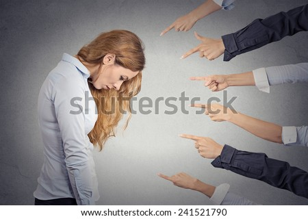 Concept of accusation of guilty businesswoman. Side profile portrait sad upset woman looking down many fingers pointing at her isolated grey office background. Human face expression emotion feeling - stock photo