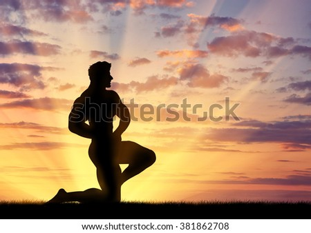 Concept of beauty and sports. Silhouette of bodybuilder poses at sunset