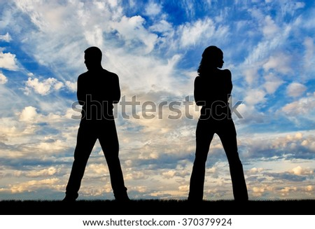 Concept of betrayal and treason. Silhouette of man and woman in a quarrel at sunset - stock photo