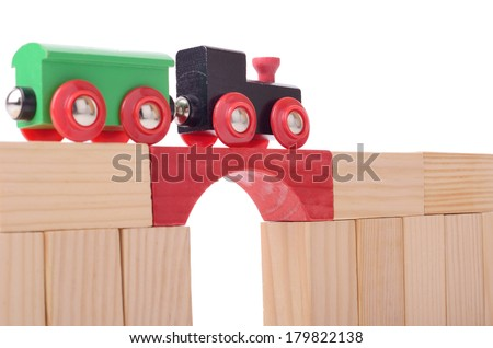concept of bridge of success a train passing over isolated on a white background - stock photo
