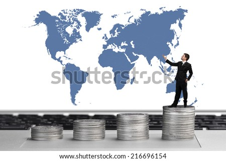 Concept of business and money growth ,business man on coins ,finance concept - stock photo