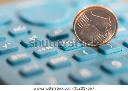 concept of business and money with one cent of Euro and a calculator keyboard