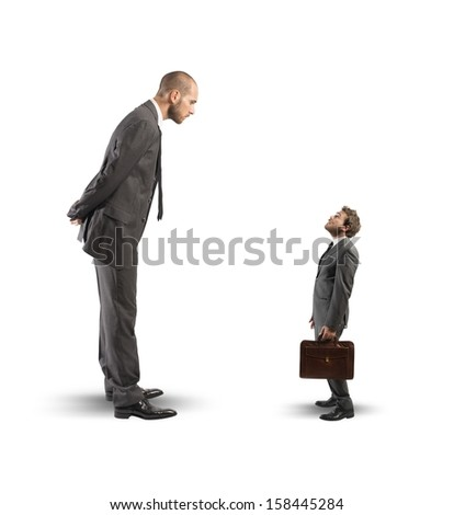 Concept of business competition with big and small businessmen - stock photo