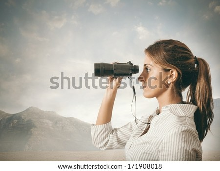 Concept of Business exploration with businesswoman and binoculars - stock photo