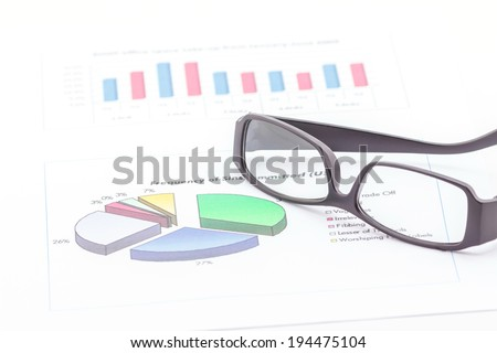 Concept of business graph and glasses on white background. - stock photo