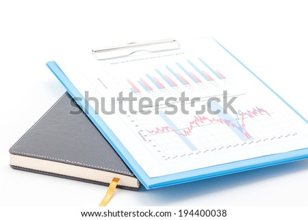 Concept of business graph on clipboard and notebook. - stock photo