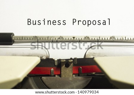 concept of business proposal, with message on typewriter. - stock photo