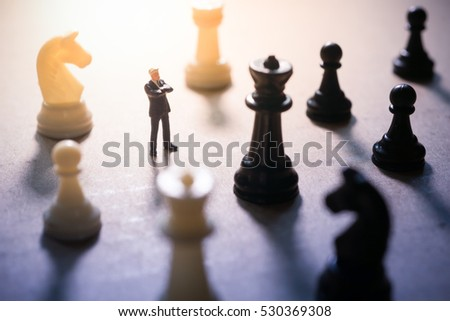 Concept of business strategy. Businessman with a chess game.