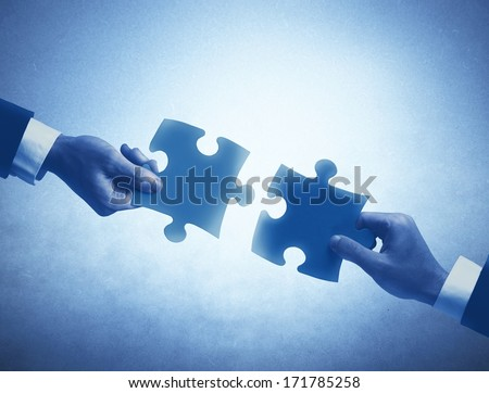 Concept of business teamwork and integration with puzzle - stock photo