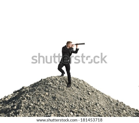 Concept of business vision with businessman with telescope - stock photo