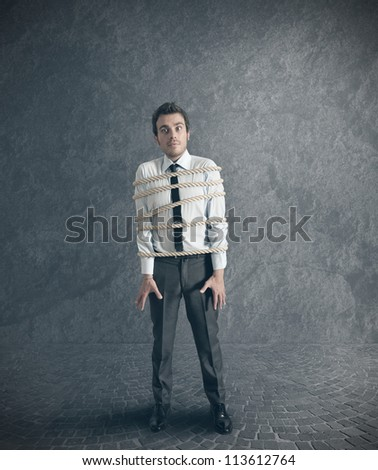 Concept of businessman blocked by economic problems - stock photo