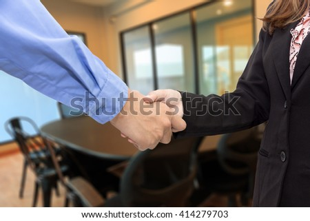 Concept of Businesswoman shaking hands in meeting room.
