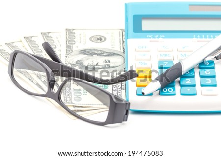 Concept of calculator, US Dollar, eyeglasses and pen.