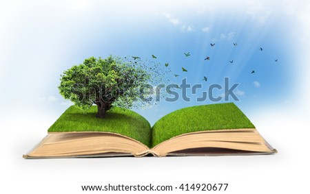 Concept of changes. Open book full of grass with a tree that turns into a birds.