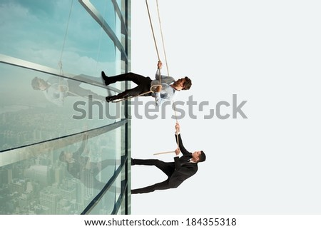 Concept of competition with climbing businessman - stock photo