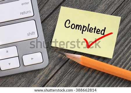 concept of completed with tick sign on a note