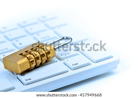 Concept of computer and online security with keyboard and padlock toned in blue  - stock photo