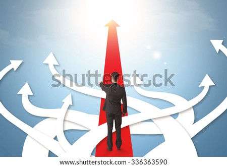 Concept of confused businessman with different direction arrows - stock photo