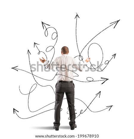 Concept of confused choice of a businessman with arrows - stock photo