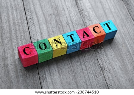 concept of contact on colorful wooden cubes - stock photo