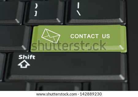 Concept of contact us call to  action. The focus is on the enter key with the shift button on the bottom - stock photo