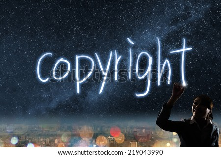 Concept of copyright, silhouette asian business woman light drawing. - stock photo