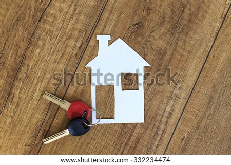 concept of couple decides to live together. keys and the house symbolizes the decision couples start living together