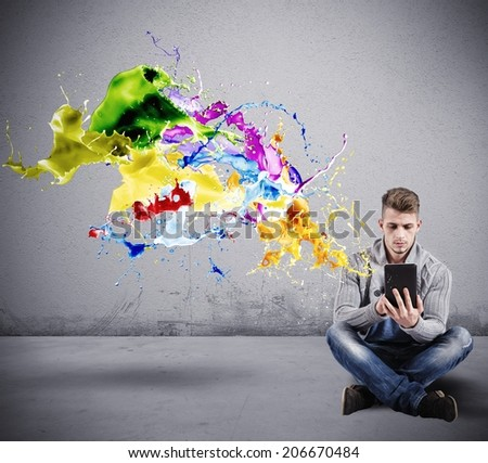 Concept of Creative technology with a boy with a tablet - stock photo
